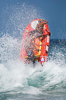 The North Steyne (Manly) inflatable rescue boat (or IRB) leaps through the surf.