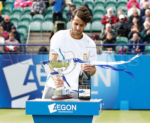 22.06.2013. Eastbourne, England.  Feliciano Lopez(ESP) defeats Giles Simon(FRA) in the mens Singles Finals by a score 7-6, 6-7, 6-0 during the AEGON International tournament at Devonshire Park. Lopez receives his winners spoils