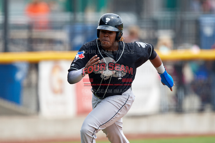 Lansing Lugnuts third baseman Vladimir Guerrero Jr. (27) runs home during a game against the Clinton LumberKings on May 9, 2017 at Ashford University Field in Clinton, Iowa.  Lansing defeated Clinton 11-6.  (Mike Janes/Four Seam Images)