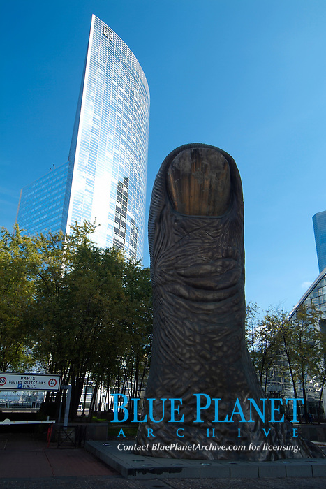 The finger Statue by César in La Défense district in Paris, Capital of France. La Défense is the prime high-rise office district of Paris. Many of Paris's tallest buildings can be found here. The district is a mix of mostly cheap towers of different heights. The tallest of them, the GAN tower, measured 179 meters (589 ft). The height of several towers, and in particular the GAN tower caused a public outcry as the 'forest of towers' disturbs the view on the Arc de Triomphe as seen from the Etoile. Partly in response to this criticism a new monument was built at the entrance of the Défense as a counterweight for the Arc de Triomphe: The Tête Défense , also known as the Grande Arche de la Défense.