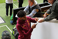 Tyrone Mings of Aston Villa signs an autograph before the game.<br /> during Norwich City vs Aston Villa, Premier League Football at Carrow Road on 5th October 2019
