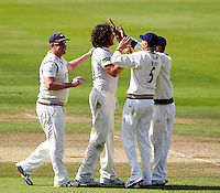 PICTURE BY ALEX WHITEHEAD/SWPIX.COM - Cricket - County Championship Div Two - Yorkshire v Glamorgan, Day 3 - Headingley, Leeds, England - 06/09/12 - Yorkshire's Ryan Sidebottom celebrates the wicket of Glamorgan's Mark Wallace with team-mates.