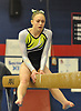 Ava Dallas performs on the balance beam during the NYSPHSAA varsity gymnastics state championship meet at Cold Spring Harbor High School on Saturday, March 3, 2018.