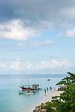 ZANZIBAR, Nungwi Beach, People at the beach are heading to go on Safari Boats