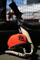Netherlands National Team hat, glove, and bat in the dugout before a spring exhibition game against the Pittsburgh Pirates at Al Lang Field on March 12, 2012 in St. Petersburg, Florida.  (Mike Janes/Four Seam Images)