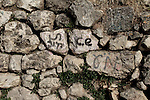 Hebrew inscriptions are seen in the remains of a wall in Lifta, a Palestinian village in the outskirts of Jerusalem, whose Palestinian inhabitants fled in 1948. The village, the last standing Palestinian village of its kind, is about to be turned into a luxury Israeli neighborhood,  Photo by Quique Kierszenbaum