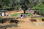 Tourists in the water gardens of Sigiriya rock palace, Central Province, Sri Lanka, Asia