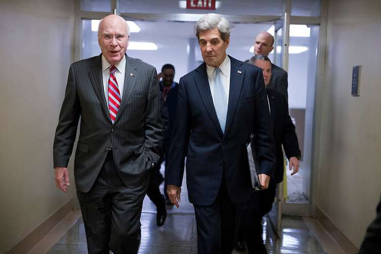 UNITED STATES - JANUARY 30:  Sen. Patrick Leahy, D-Vt., left, and incoming Secretary of State Sen. John Kerry, D-Mass., make their way through the senate subway en route to the Senate floor where Kerry gave his farewell address.  (Photo By Tom Williams/CQ Roll Call)