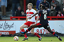 Mark Roberts of Stevenage clears from Hope Akpan of Crawley. Stevenage v Crawley Town - npower League 1 -  Lamex Stadium, Stevenage - 15th December, 2012. © Kevin Coleman 2012..