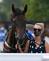 Winner of The British Stallion Studs EBF Odstock Fillies' Handicap Almareekh and Lass in the Parade ring during Horse Racing at Salisbury Racecourse on 13th August 2020