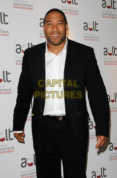 JOHN BARNES.Inside arrivals at the ACLT launch Party, Riverbank Park Plaza Hotel, London, England, April 28th 2008..half length black jacket white shirt.CAP/CAN.©Can Nguyen/Capital Pictures
