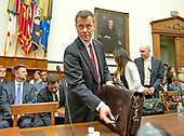 "FBI Deputy Assistant Director Peter Strzok arrives at the witness table prior to giving testimony during a joint hearing of the United States House Committee on the Judiciary and the US House Committee on Oversight and Government Reform on ""Oversight of FBI and DOJ Actions Surrounding the 2016 Election"" on Capitol Hill in Washington, DC on Thursday, July 12, 2018. <br /> Credit: Ron Sachs / CNP<br /> (RESTRICTION: NO New York or New Jersey Newspapers or newspapers within a 75 mile radius of New York City)"