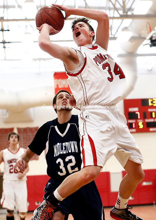 Southbury, CT- 26 January 2013-012613CM10-   Pomperaug's Nate Rubinstein gets off a shot around Middletown's  Andrew Mierzejewski during boys basketball action against Middletown Saturday afternoon in Southbury.   Christopher Massa Republican-American