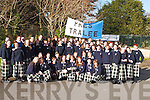 CHAMPIONS: Emma Sherwood (front centre), Captain of the Under 16 Presentation Secondary School Basketball Team, Tralee, holding the Schools Under 16 Cup on Thursday last, which they won in Tallaght. Cheering the Team on were her classmates on Friday..