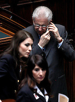 Il Presidente del Consiglio Mario Monti parla al cellulare in attesa di votare durante la quinta seduta comune di senatori e deputati per l'elezione del nuovo Capo dello Stato alla Camera dei Deputati, Roma, 20 aprile 2013..Italian Premier Mario Monti speaks on his mobile phone as he waits to vote during the fifth common plenary session of senators and deputies to elect the new Head of State, at the Lower Chamber in Rome, 20 April 2013..UPDATE IMAGES PRESS/Isabella Bonotto