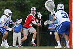 09 May 2015: Ohio State's David Planning (12) is watched by Duke's Danny Fowler (3) and Pat Resch (34). The Duke University Blue Devils hosted the Ohio State University Buckeyes at Koskinen Stadium in Durham, North Carolina in a 2015 NCAA Division I Men's Lacrosse Tournament First Round match. Ohio State won the game 16-11.