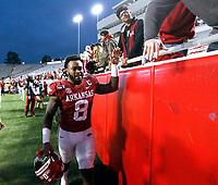 Arkansas Democrat-Gazette/THOMAS METTHE -- 11/29/2019 --<br /> Arkansas linebacker De'Jon Harris (8) shakes hands with fans as he leaves the field after the Razorbacks' 24-14 loss to Missouri on Friday, Nov. 29, 2019, at War Memorial Stadium in Little Rock.