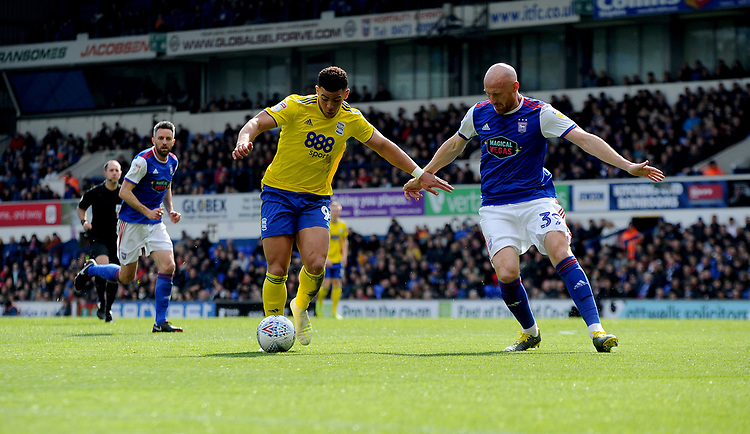 Birmingham City's Che Adams battles with Ipswich Town's James Collins<br /> <br /> Photographer Hannah Fountain/CameraSport<br /> <br /> The EFL Sky Bet Championship - Ipswich Town v Birmingham City - Saturday 13th April 2019 - Portman Road - Ipswich<br /> <br /> World Copyright © 2019 CameraSport. All rights reserved. 43 Linden Ave. Countesthorpe. Leicester. England. LE8 5PG - Tel: +44 (0) 116 277 4147 - admin@camerasport.com - www.camerasport.com