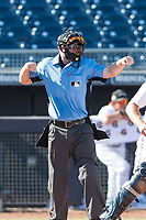 Home plate umpire Brian Peterson calls a batter out on strikes during an Arizona Fall League game between the Glendale Desert Dogs and the Peoria Javelinas at Peoria Sports Complex on October 22, 2018 in Peoria, Arizona. Glendale defeated Peoria 6-2. (Zachary Lucy/Four Seam Images)