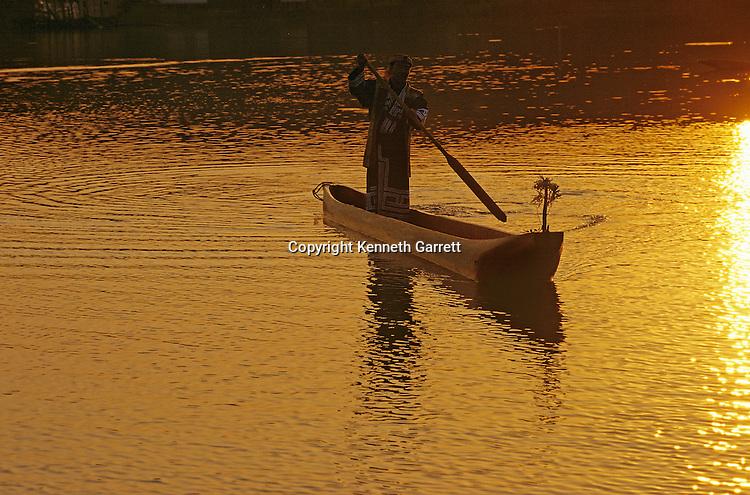 Descendants of Japan's late Ice Age people, the Ainu travel by dugout canoe, Hokkaido Island, Japan.