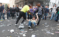 30.08.10 A festival goer gets repeatedly kicked after he threw a bottle and it actually flew into the people on the drum and bass stage at Notting Hill Carnival. He was aiming the bottle at police.