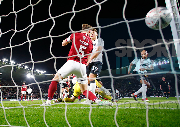 Andre Wisdom of Derby County (r) scores the first goal during the FA Cup match at the Pride Park Stadium, Derby. Picture date: 4th February 2020. Picture credit should read: Darren Staples/Sportimage