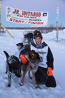 Ben Harper portrait with lead dogs at the finish line of the 2014 Jr. Iditarod Sled Dog Race at Happy Trails Kennel, Big Lake, Alaska<br /> Sunday February 23, 2014 <br /> <br /> Junior Iditarod Sled Dog Race 2014<br /> PHOTO BY JEFF SCHULTZ/IDITARODPHOTOS.COM  USE ONLY WITH PERMISSION
