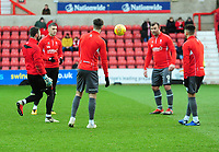 Lincoln City substitutes during the pre-match warm-up<br /> <br /> Photographer Andrew Vaughan/CameraSport<br /> <br /> The EFL Sky Bet League Two - Swindon Town v Lincoln City - Saturday 12th January 2019 - County Ground - Swindon<br /> <br /> World Copyright &copy; 2019 CameraSport. All rights reserved. 43 Linden Ave. Countesthorpe. Leicester. England. LE8 5PG - Tel: +44 (0) 116 277 4147 - admin@camerasport.com - www.camerasport.com