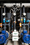 September 9, 2014. Research Triangle Park, North Carolina.<br />  Several heavy duty pumps below the greenhouse push the fertigation system which mixes carefully monitored combinations of reverse osmosis filtered water and fertilizers.<br /> The Syngenta Advanced Crop Lab is nearly one acre of advanced agricultural research under glass. The lab is capable of maintaining many different environments under its roof, allowing scientists to test the effects of various environmental elements on different crops and plants side by side.