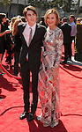 LOS ANGELES, CA - SEPTEMBER 15: Brenda Strong and Zak Henri arrive at the 2012 Primetime Creative Arts Emmy Awards at Nokia Theatre L.A. Live on September 15, 2012 in Los Angeles, California.