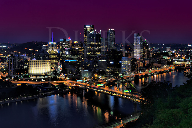 Pittsburgh at night with the Fort Pitt Bridge going over the Monongahela River and the Parkway glowing orange. Taken from the West End Overlook, and in my opinion, this city is one of the most beautiful in the darkness.
