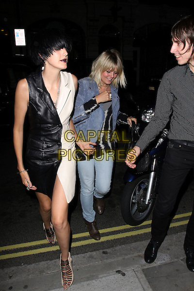 AGYNESS DEYN & GUEST.At Bungalow 8, London, England..September 21st, 2009.full length black white leather dress dark dyed hair red lipstick shoes strappy sandals.CAP/AH.©Adam Houghton/Capital Pictures.