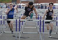 NWA Democrat-Gazette/ANDY SHUPE<br /> Fayetteville's Isaiah Sategna (center) clears the final hurdle Friday, April 12, 2019, while leading Clay Workman of Rogers (left) and Solomon Evans of Fayetteville to win the 110-meter hurdles during the Bulldog Relays at Ramay Junior High School in Fayetteville. Visit nwadg.com/photos to see more photographs from the meet.