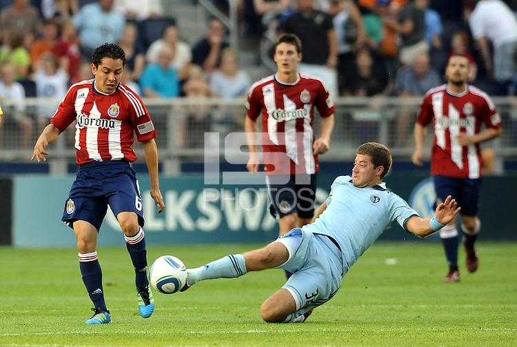The outstretched leg of Sporting KC midfielder Luke Sassano clears the ball... Sporting KC and Chivas USA played to a 1-1 tie at LIVESTRONG Sporting Park, Kansas City, Kansas.
