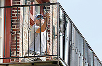 NWA Democrat-Gazette/DAVID GOTTSCHALK  Carlos Franco paints an exterior set of railings Tuesday, September 1, 2015 on the Three Sisters Building on Dickson Street in Fayetteville. Franco maintains both the exterior and interior on the multipurpose building.
