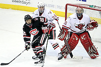 Nebraska-Omaha goalie John Faulkner awaits a shot as Bryce Aneloski and St. Cloud State's David Eddy battle in front of the net during Friday's game. Faulkner finished with 33 saves to earn a school-record and NCAA-leading sixth shutout. UNO beat St. Cloud State 3-0 Friday night at Qwest Center Omaha. (Photo by Michelle Bishop).