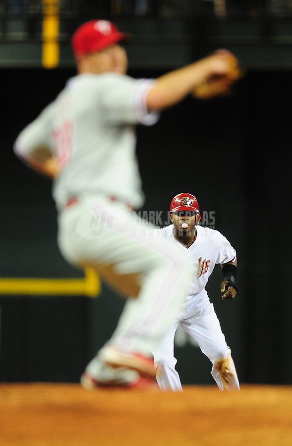 Apr. 25, 2011; Phoenix, AZ, USA; Arizona Diamondbacks baserunner Justin Upton leads off second base as Philadelphia Phillies pitcher Cliff Lee throws in the sixth inning at Chase Field. Mandatory Credit: Mark J. Rebilas-