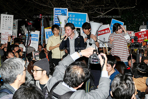 Aki Okuda leader of the Students Emergency Action for Liberal Democracy (SEALDs) chants in front of the Japanese Diet building during a protest against new security legislation which comes into effect form today March 29, 2016, in Tokyo, Japan. Last Tuesday, Prime Minister Shinzo Abe's Cabinet decided to give the green light to a change in the interpretation of the country's post war constitution that will allow Japan's Self-Defence Forces to fight alongside the US and other allies in overseas conflicts. The new legislation could also see Japanese Self-Defence Forces dispatched to United Nations peacekeeping operations. Many Japanese oppose the new legislation and fear that it could see their country being dragged into overseas conflicts. The Abe government in turn sees the change as a chance to become more actively involved in the international community. (Photo by Rodrigo Reyes Marin/AFLO)