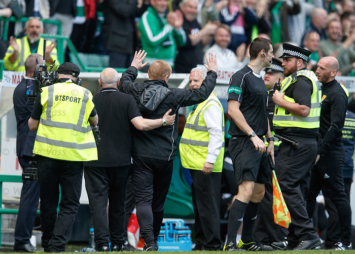 13.05.2018 Hibs v Rangers: Neil Lennon led away from the dugouts after running onto the park