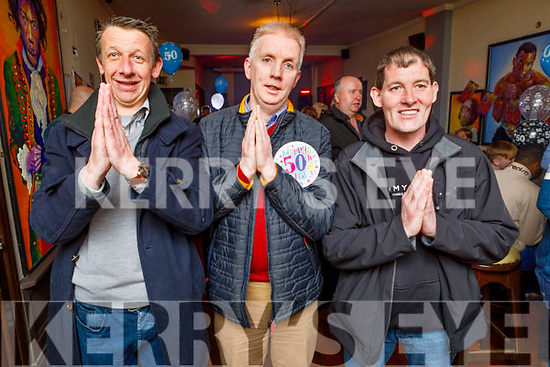 Best friends Aidan Griffin and Liam McGovern hepling Jeremiah Moriarty from Manor Ave celebrate his 50th birthday in the Sliabh Mish Bar on Friday.