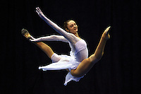 Anna Bessonova of Ukraine split leaps handsfree during gala exhibition at San Francisco Invitational on February 11, 2006. Bessonova won All-Around competition. (Photo by Tom Theobald)