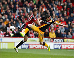 Chris Basham of Sheffield Utd in action with Alex Jones of Bradford City during the English League One match at Bramall Lane Stadium, Sheffield. Picture date: April 17th 2017. Pic credit should read: Simon Bellis/Sportimage