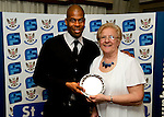 St Johnstone FC Players Awards Night...01.05.11  Lovatt Hotel Perth..Michael Duberry is presented with the Jeanfield 208 Supporters Club Cult Hero Award from Gert Gordon..Picture by Graeme Hart..Copyright Perthshire Picture Agency.Tel: 01738 623350  Mobile: 07990 594431