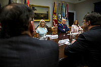 U.S. President Donald Trump holds an opioid round table at the White House in Washington, DC, USA, 12 June 2019. Also pictured are White House Counselor Kellyanne Conway and U.S. First Lady Melania Trump.<br /> Credit: Zach Gibson / Pool via CNP/AdMedia