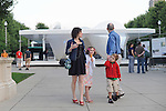 A family walks outside the Burnham Pavilion designed by Zaha Hadid in Millennium Park in Chicago, Illinois on July 23, 2009.