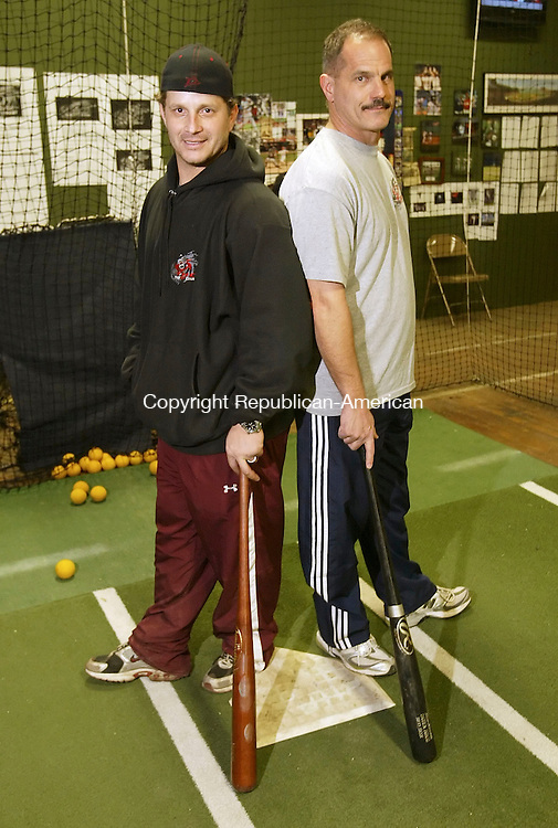 WATERTOWN, CT 01/09/08-010908BZ15- Darren Bragg and Carmine Farese pose in one of the batting cages at The Hit Club in Thomaston Wednesday night.<br /> Jamison C. Bazinet Republican-American