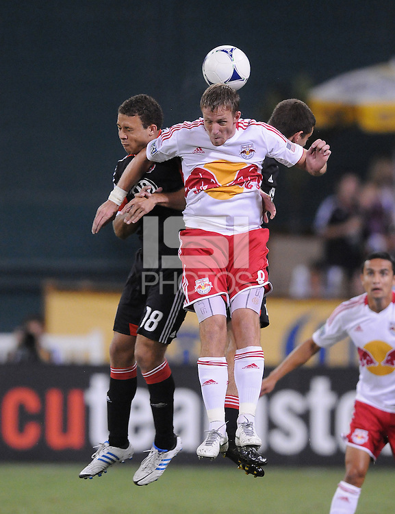 New York Red Bulls midfielder Jan Gunnar Solli (8) heads the ball against D.C. United midfielder Nick DeLeon (18) The New York Red Bulls tied D.C. United 2-2 at RFK Stadium, Wednesday August 29, 2012.
