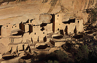 Aerial view of the Cliff Palace, 13th century, a huge multi-storey Native American Puebloan dwelling, housing 125 people, with 23 kivas and 150 rooms, in Mesa Verde National Park, Montezuma County, Colorado, USA. The Cliff Palace is the largest cliff house in the park, possibly used for social and ceremonial purposes and is thought to be part of a larger community encompassing 60 pueblos and 600 people. It is made from sandstone blocks, mortar and wooden beams and was originally painted with earthen plasters. Mesa Verde is the largest archaeological site in America, with Native Americans inhabiting the area from 7500 BC to 13th century AD. It is listed as a UNESCO World Heritage Site. Picture by Manuel Cohen