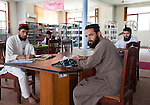 2 June 2013,  Jalalabad, Afghanistan.  Students sit in the main library building at Nangarhar University in Jalalabad.  Many of the facilities and equipment at the University are being provided under the World Bank funded Strengthening Higher Education Program (SHEP). The objective of the program is to restore basic operational performance at a group of core universities in Afghanistan. It aims to act as a catalyst to attract resources at Afghan tertiary education in the long term.  SHEP is the first major education investment in Afghanistan by the World Bank. In 2008 it received $US 5 million from ARTF to expand infrastructure and equipment to Universities in Kabul, Nangarhar , Balkh and Kandahar.  Picture by Graham Crouch/World Bank
