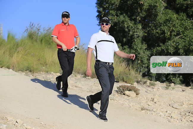 Marc Warren (SCO) and Michael HOEY (NIR) walk off the 9th tee during Thursday's Round 2 of the 2015 Commercial Bank Qatar Masters held at Doha Golf Club, Doha, Qatar.: Picture Eoin Clarke, www.golffile.ie: 1/22/2015